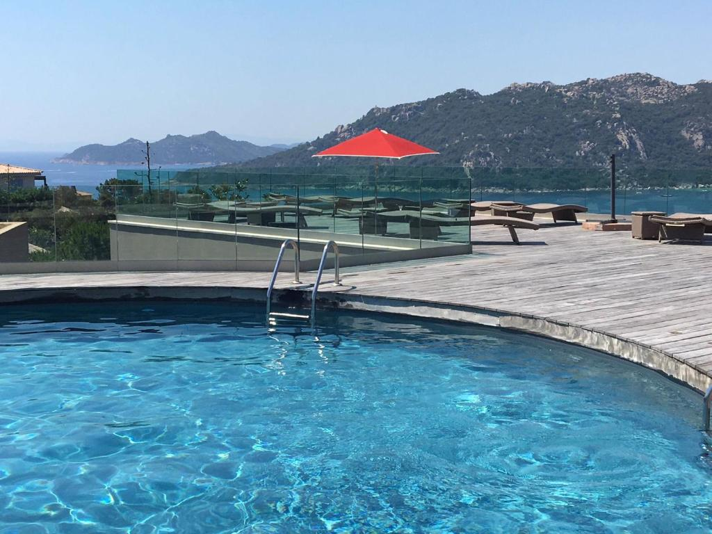 The swimming pool at or near Hotel Carre Noir