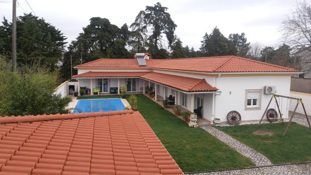 A view of the pool at CASA SAO TOMÉ or nearby