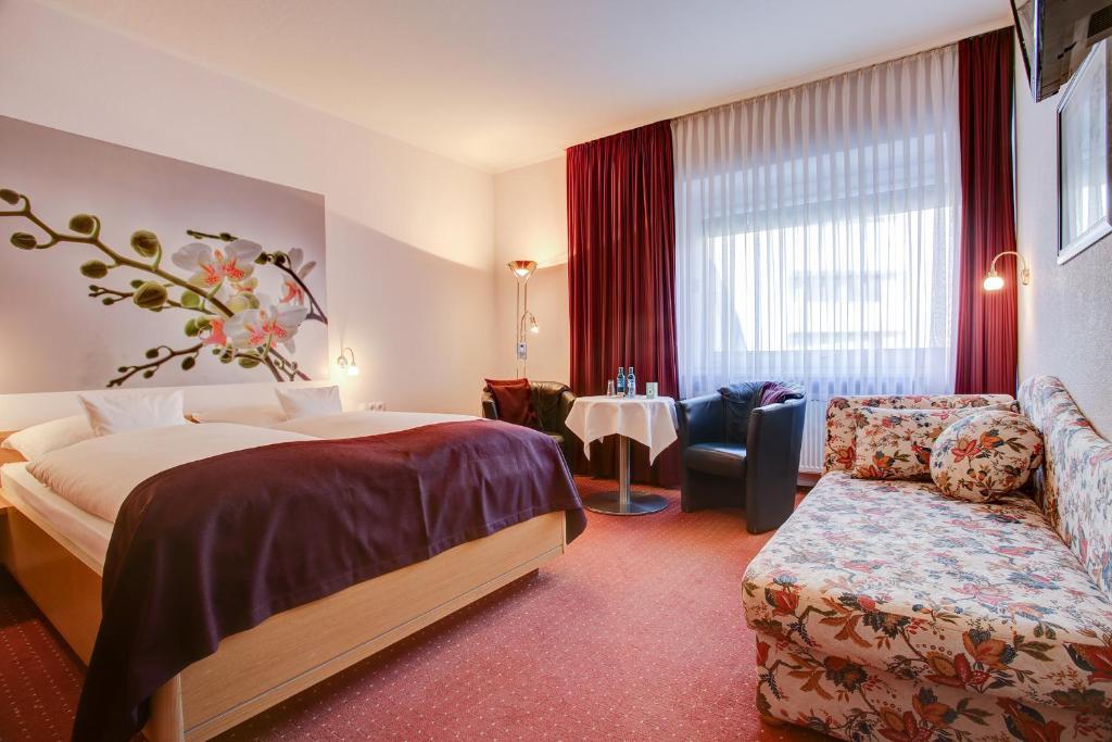 Ein Bett oder Betten in einem Zimmer der Unterkunft Centro Hotel Consul
