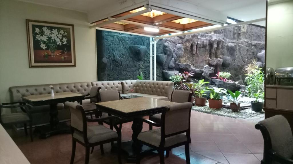 A restaurant or other place to eat at Hotel Mirah Sartika
