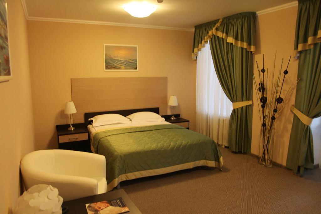 Кровать или кровати в номере Мосфильм Отель