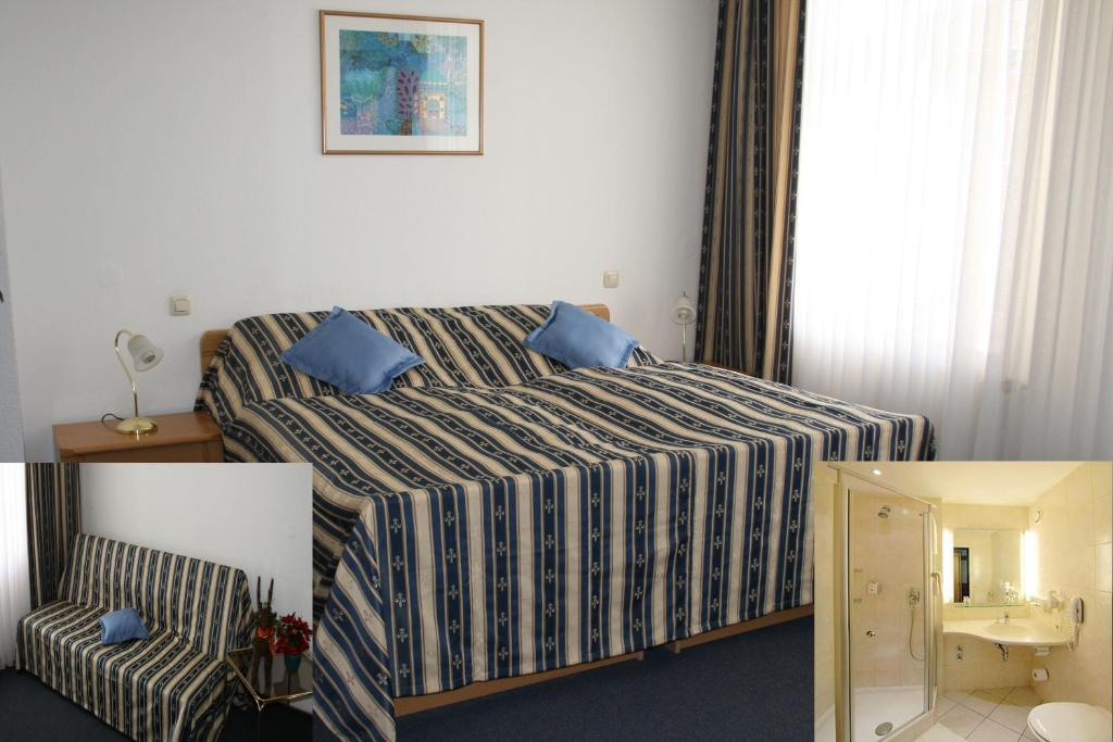 A bed or beds in a room at Hotel am Schloss Borbeck