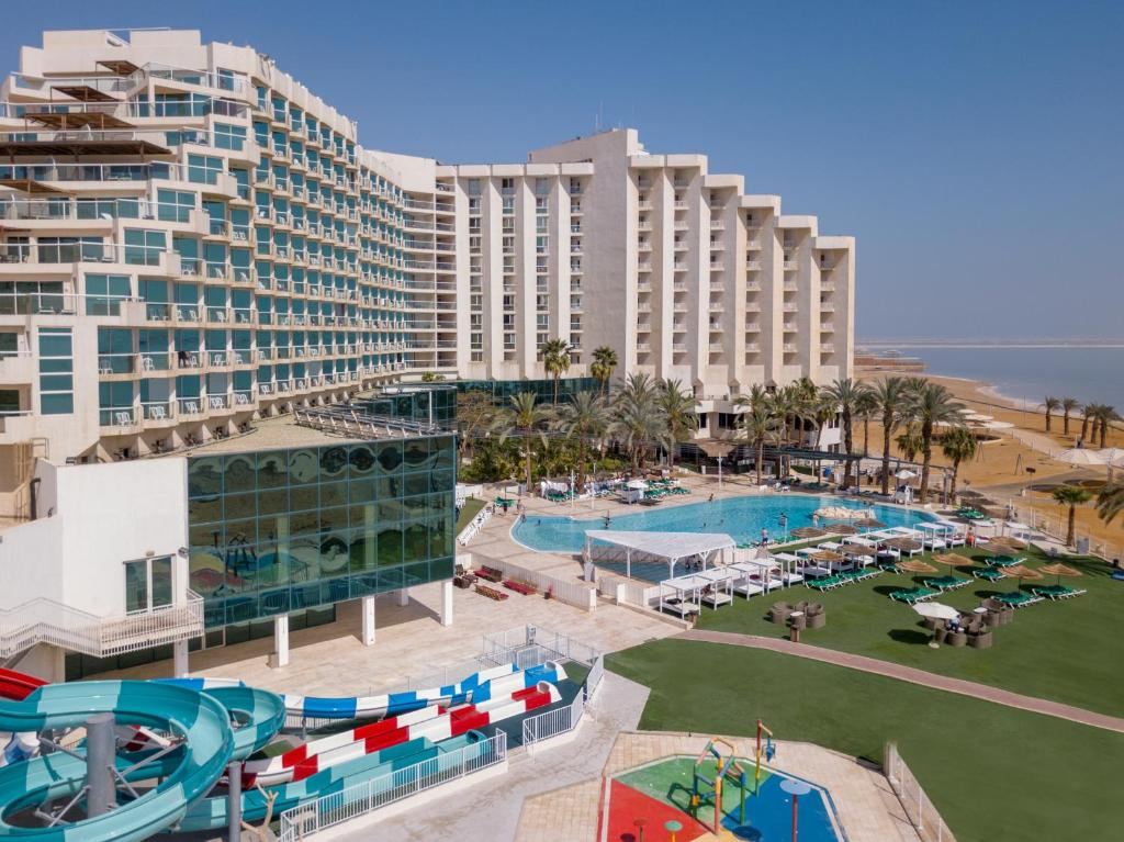 A view of the pool at Leonardo Club Hotel Dead Sea - All Inclusive or nearby