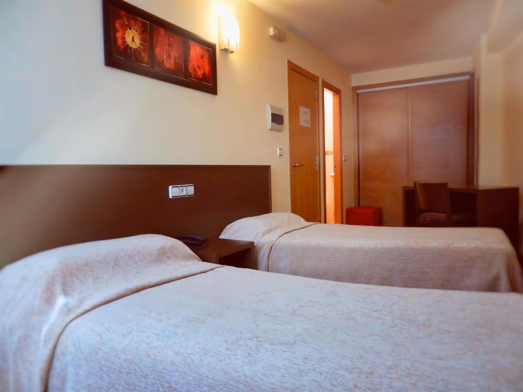 A bed or beds in a room at Hotel Santa Catalina by Bossh Hotels