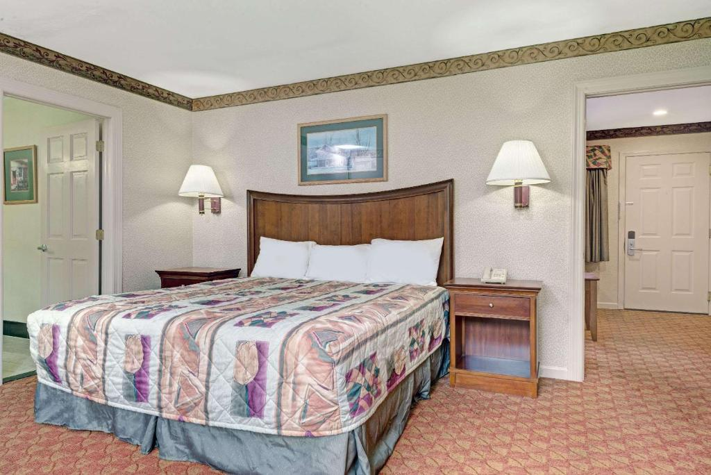 A bed or beds in a room at Days Inn by Wyndham Ridgefield