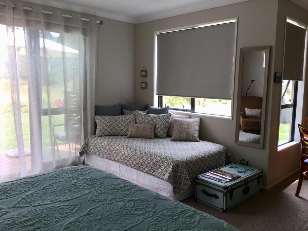 A bed or beds in a room at Abel Tasman Sands BnB