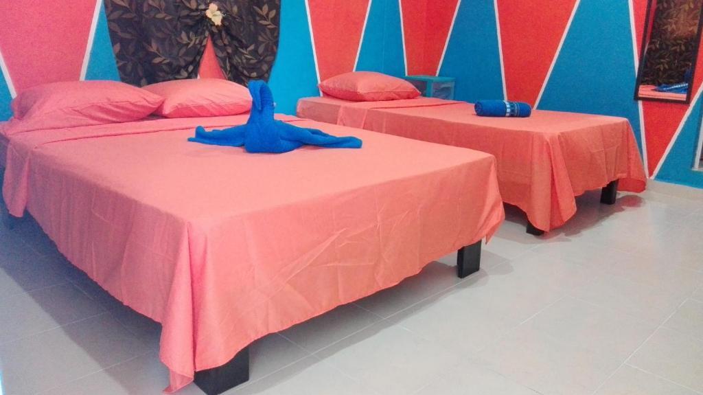 Ein Bett oder Betten in einem Zimmer der Unterkunft Appartamenti Melissa 2