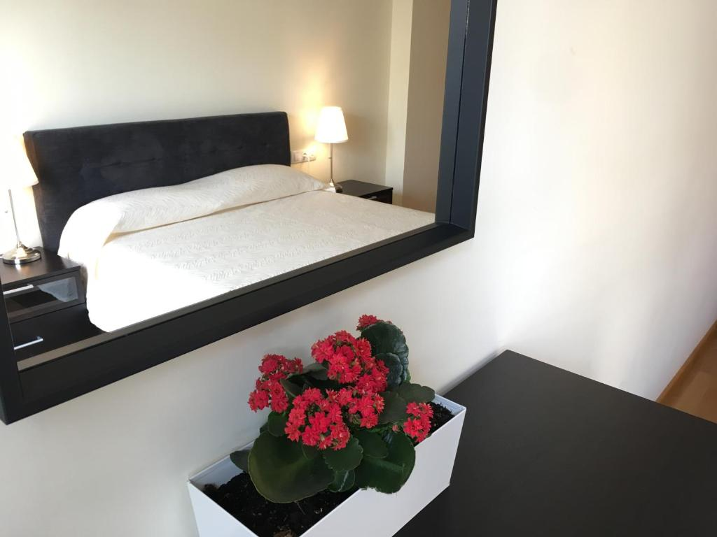 A bed or beds in a room at Sun Apartament Valencia @ City Arts & Sciences + Parking
