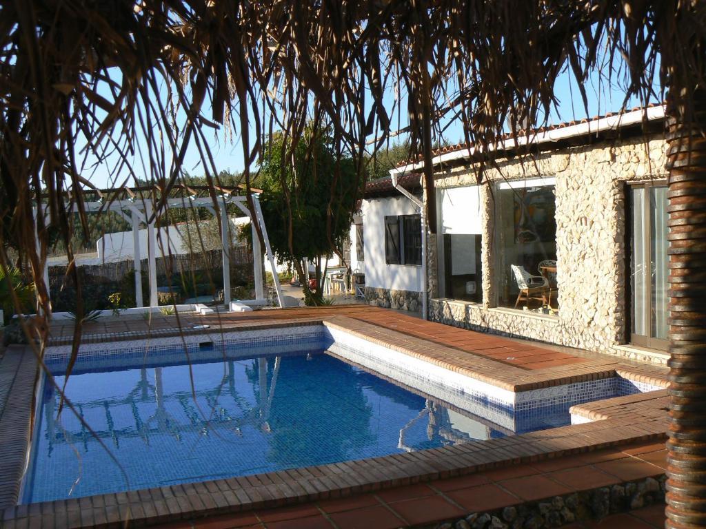 The swimming pool at or near Casa Uldina