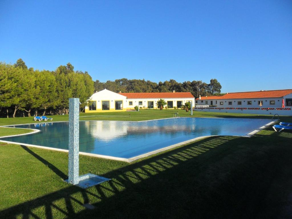 The swimming pool at or near Monte Carvalhal da Rocha