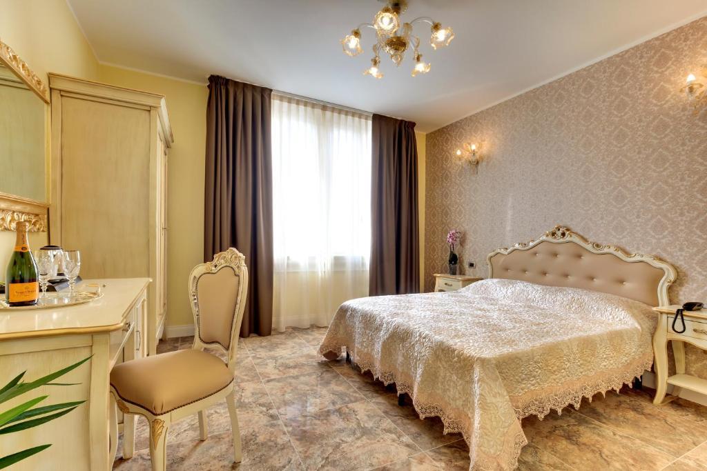 Un ou plusieurs lits dans un hébergement de l'établissement Hotel New Reiter