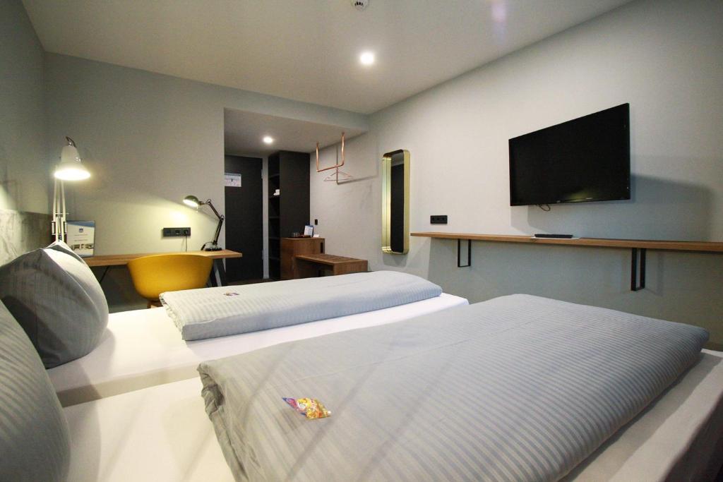 Ein Bett oder Betten in einem Zimmer der Unterkunft Novitel Hotel Kirchheim