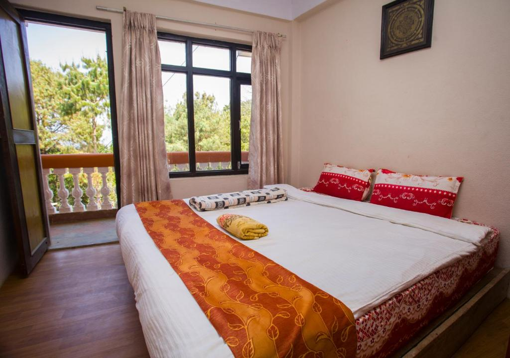 A bed or beds in a room at Langtang view Nagarkot bed and breakfast