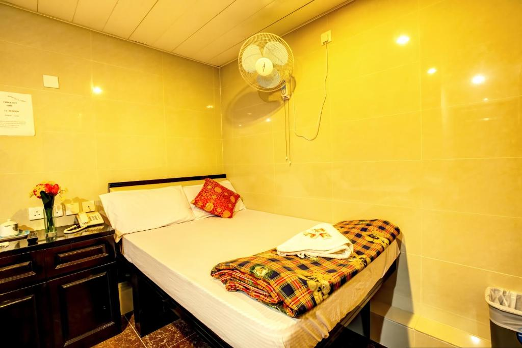 Un ou plusieurs lits dans un hébergement de l'établissement Nagaland Guesthouse