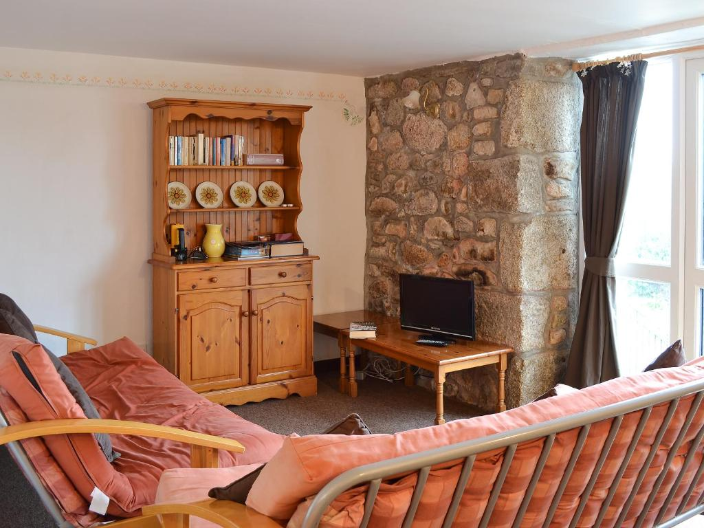 A television and/or entertainment center at Stable Cottage