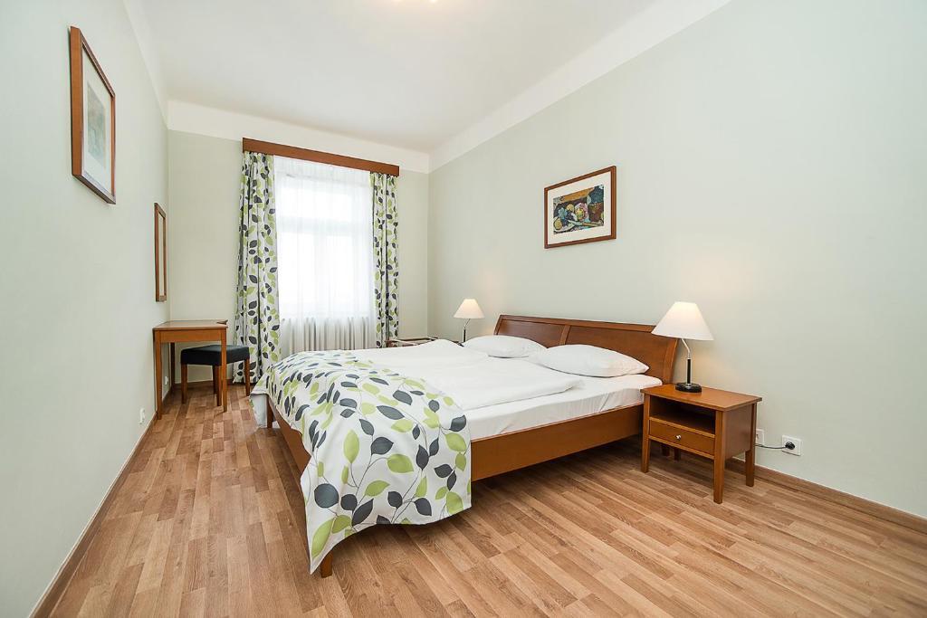 Tempat tidur dalam kamar di Hotel Orion
