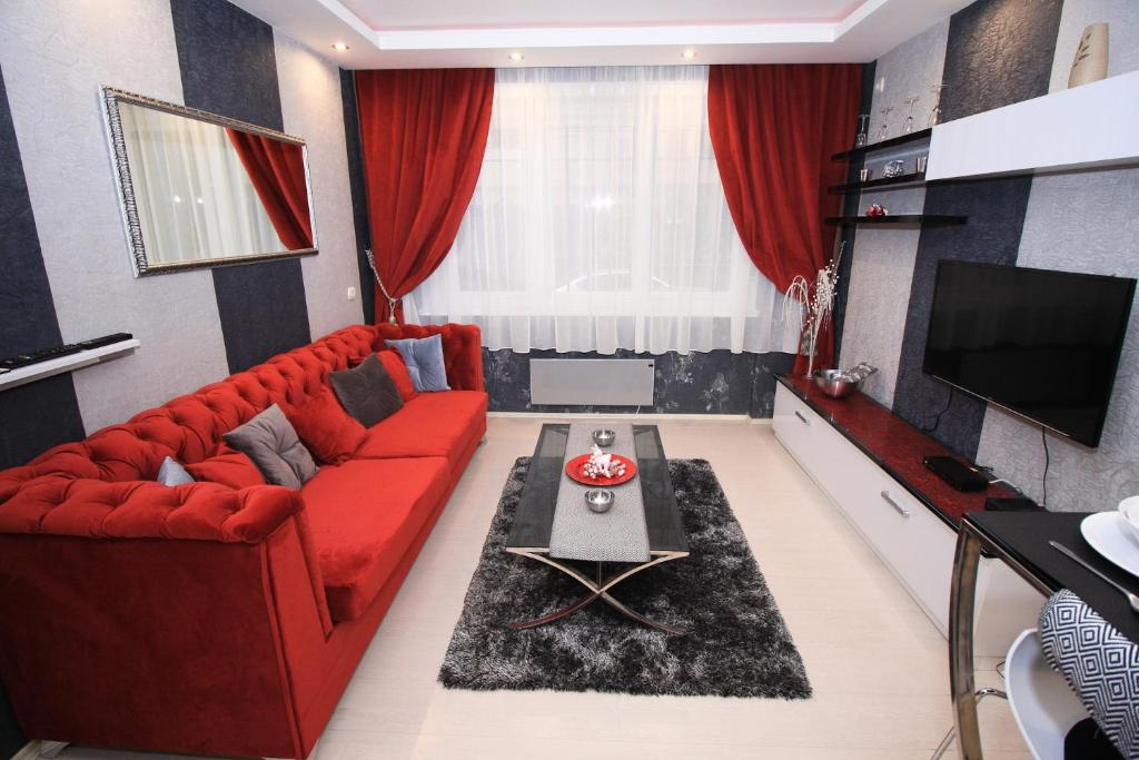 A seating area at Apartment Lovac