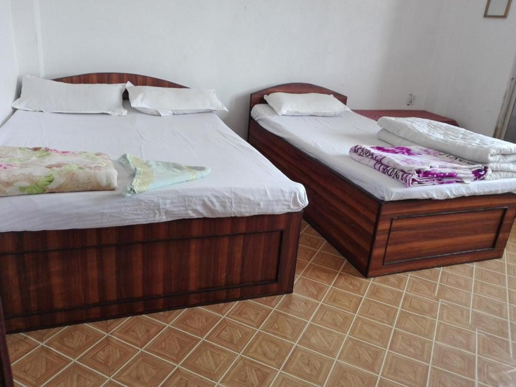 A bed or beds in a room at kayastha restaurant & lodge