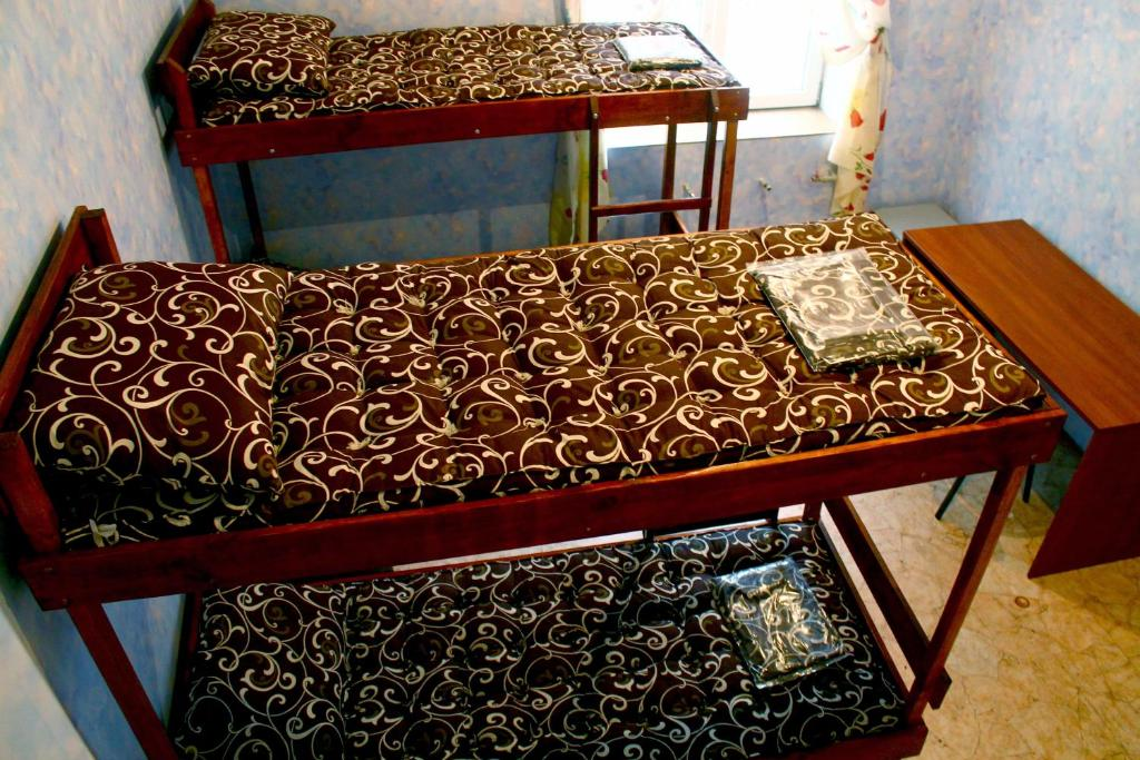 A bunk bed or bunk beds in a room at STOP Hostel