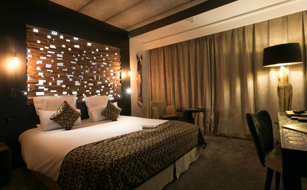 Säng eller sängar i ett rum på Mercure Bordeaux Aéroport