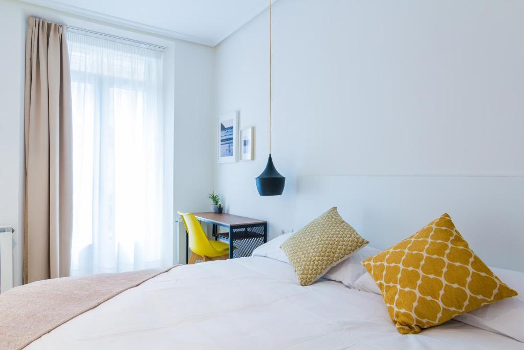 Cama o camas de una habitación en Pensión Buenpas