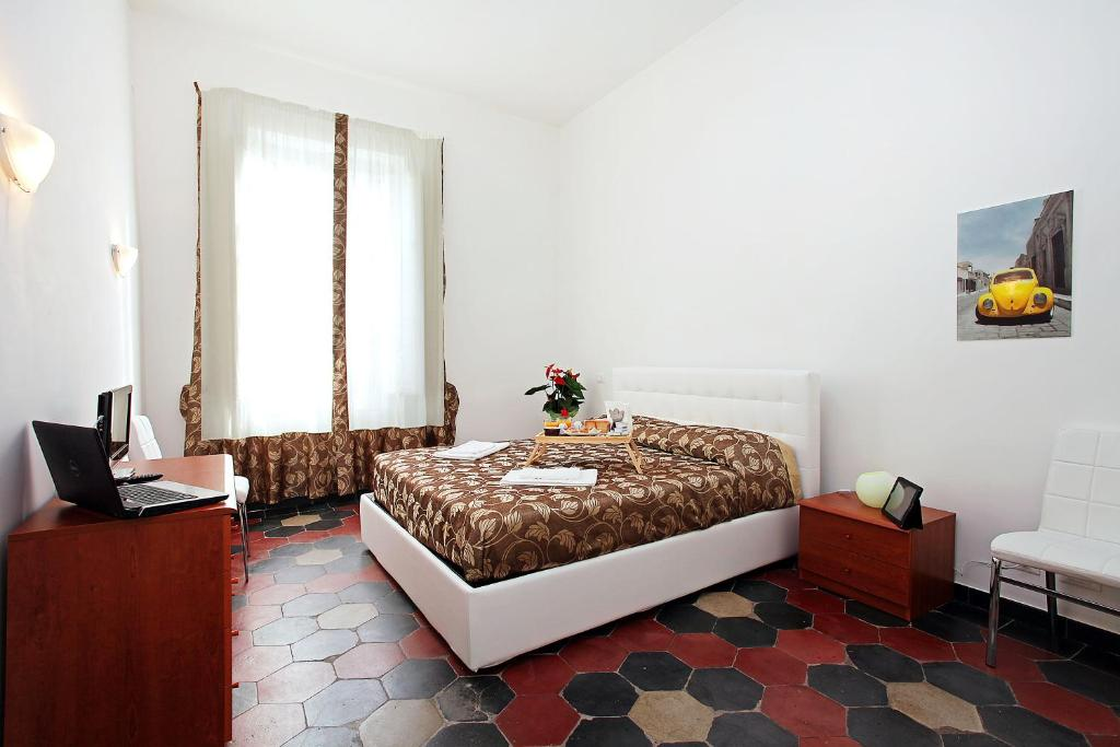 A bed or beds in a room at Angels In Rome
