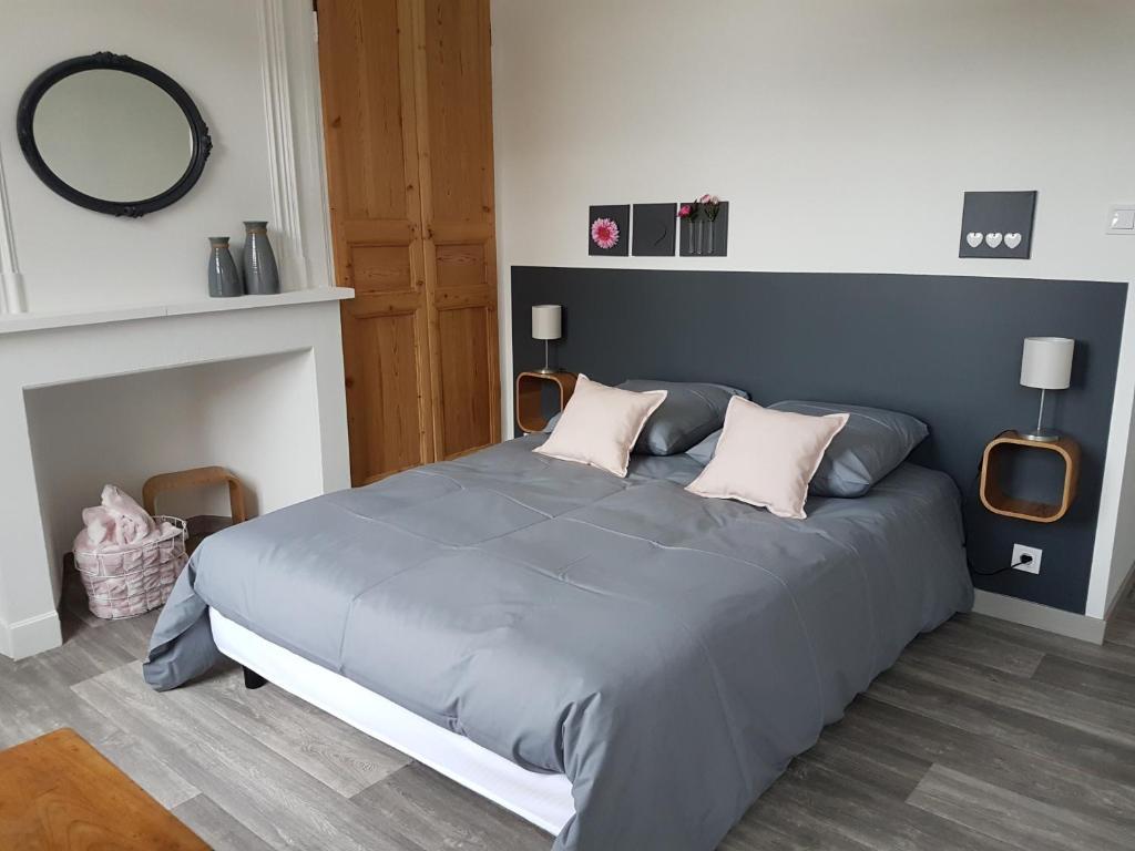 Un ou plusieurs lits dans un hébergement de l'établissement La Coucherie Chambre d'Hôtes