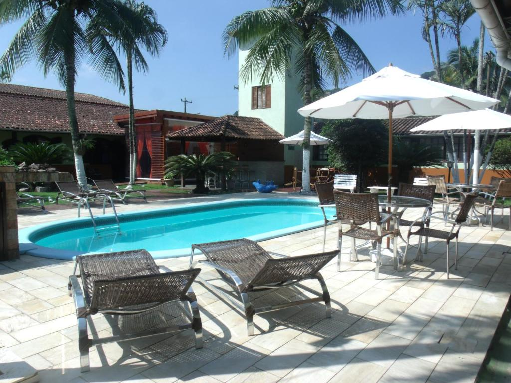 The swimming pool at or near Apart Hotel Guaiúba