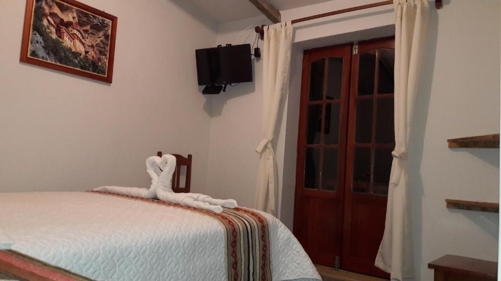 Tempat tidur dalam kamar di Gallito de las Rocas