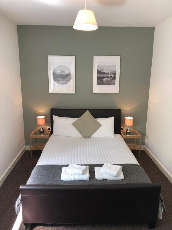 A bed or beds in a room at Rufford Court