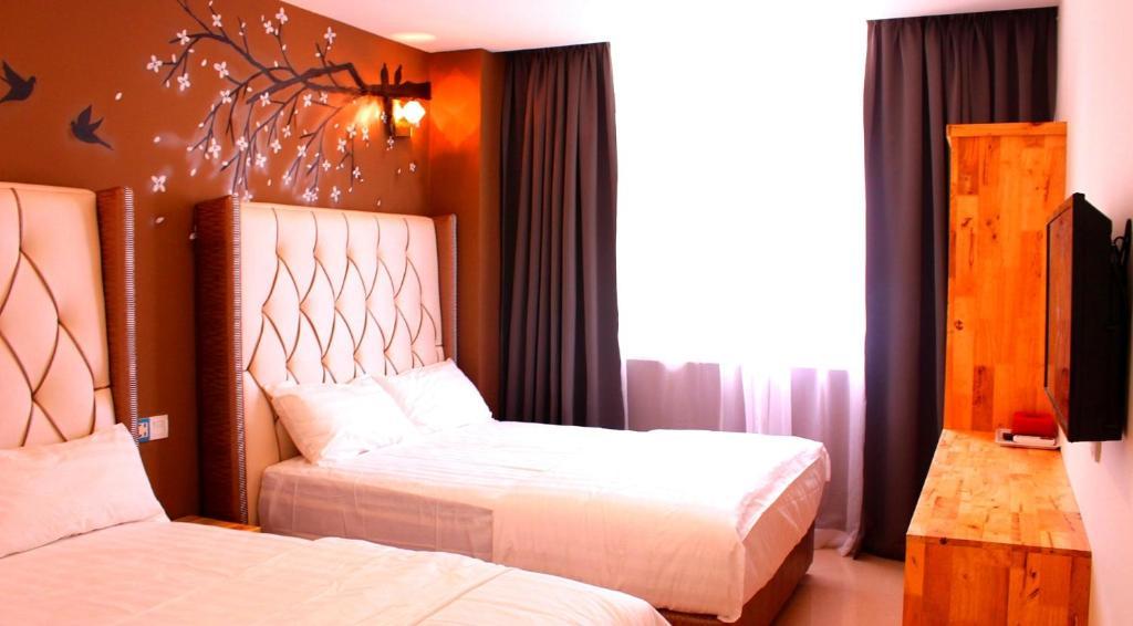 A bed or beds in a room at EV World Hotel Putrajaya