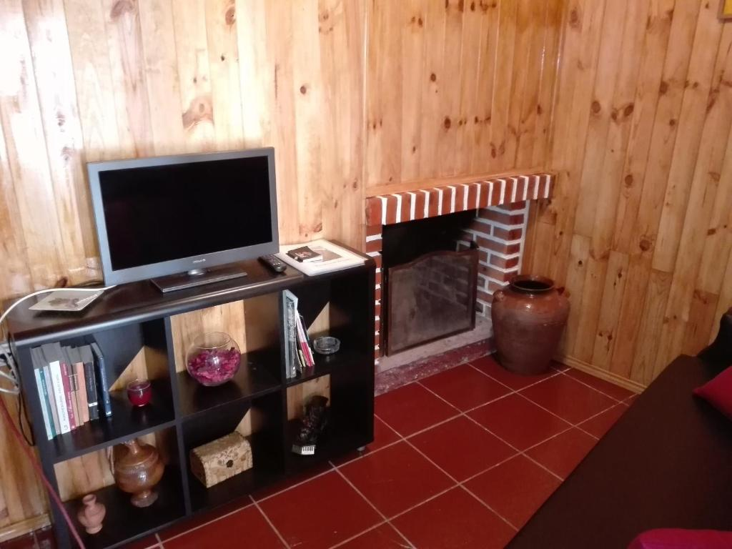 A television and/or entertainment center at Casa da Quelha