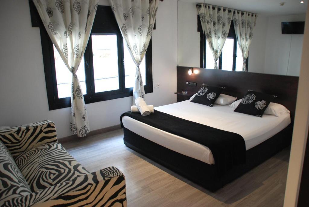 Ліжко або ліжка в номері Hotel Casita Amarilla