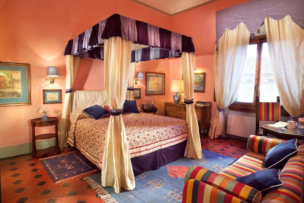 A bed or beds in a room at Antica Dimora Johlea