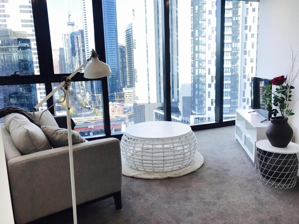 A seating area at Morden apartment near crown in CBD
