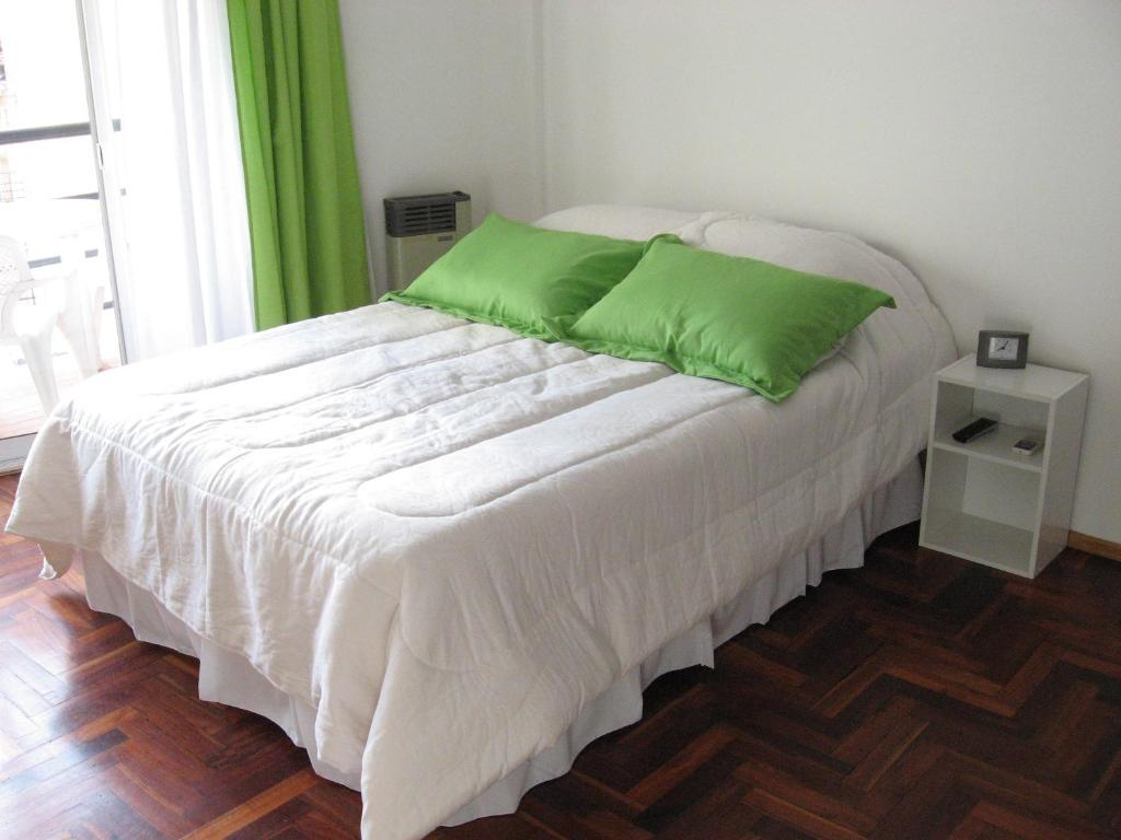 A bed or beds in a room at Palermo Rent Apartments