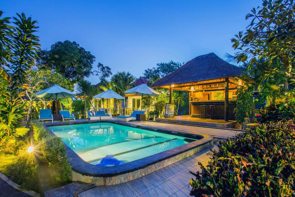 The swimming pool at or near Lotus Garden Huts