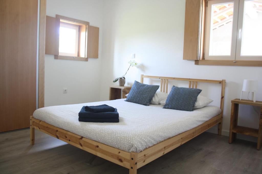 A bed or beds in a room at Casa Moderna Proxima da Praia