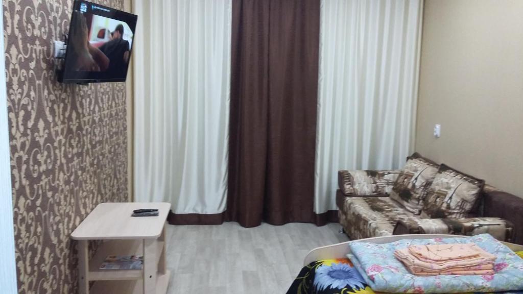 Телевизор и/или развлекательный центр в Апартаменты Гафиатуллина 13а