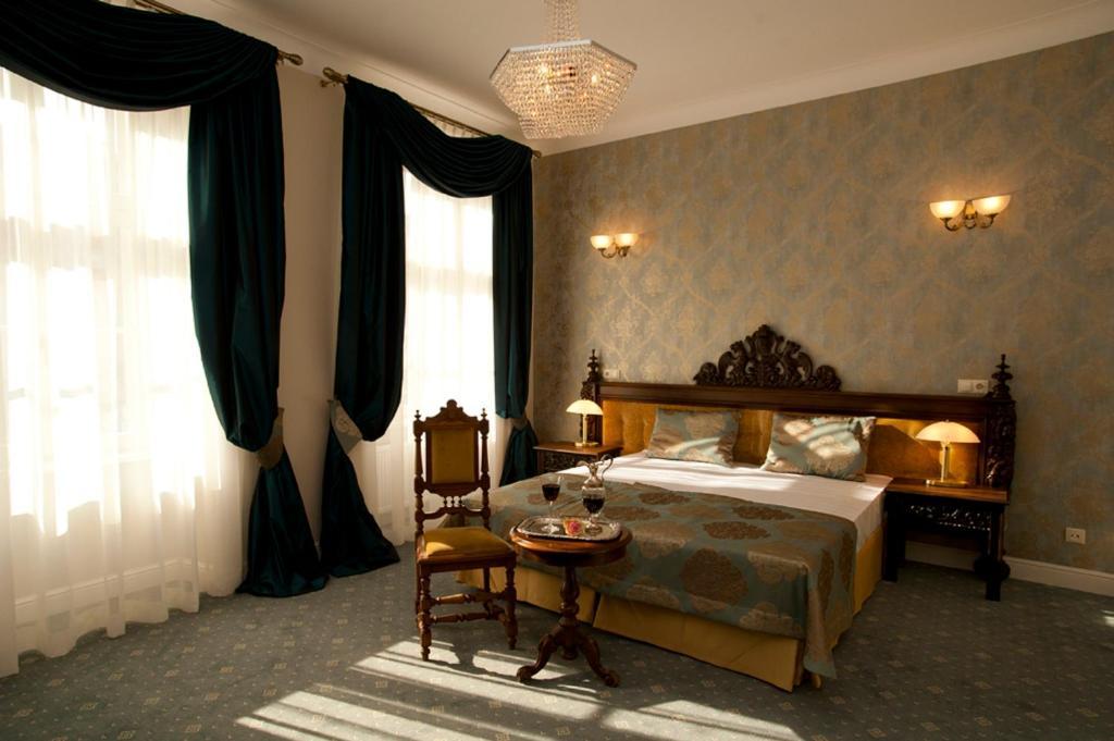 Un ou plusieurs lits dans un hébergement de l'établissement Hotel Kolegiacki