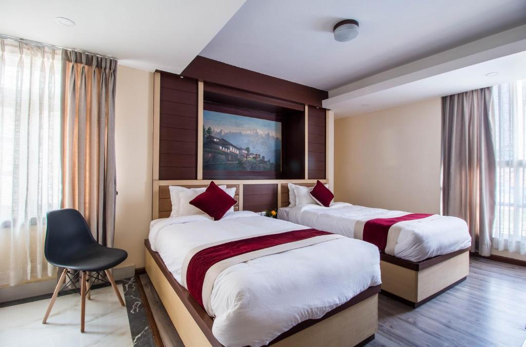 Łóżko lub łóżka w pokoju w obiekcie Hotel Himalaya Hub