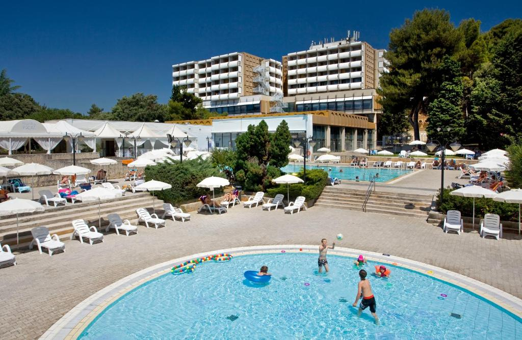 The swimming pool at or close to Pical Sunny Hotel by Valamar