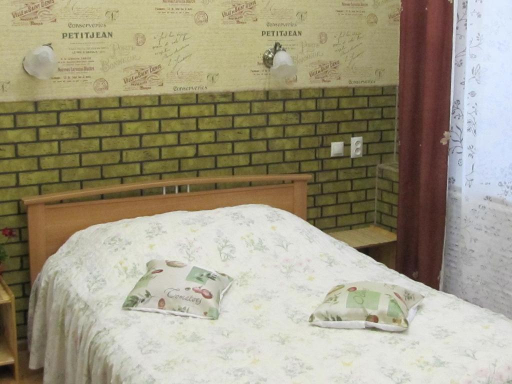 Кровать или кровати в номере Apartment on Mira 4/1