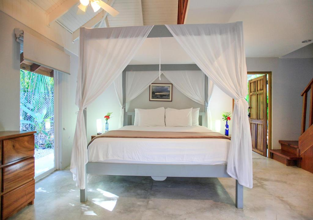 En eller flere senger på et rom på Casa Cecilia