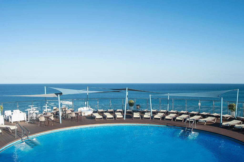 The swimming pool at or near Hotel El Puerto by Pierre Vacances
