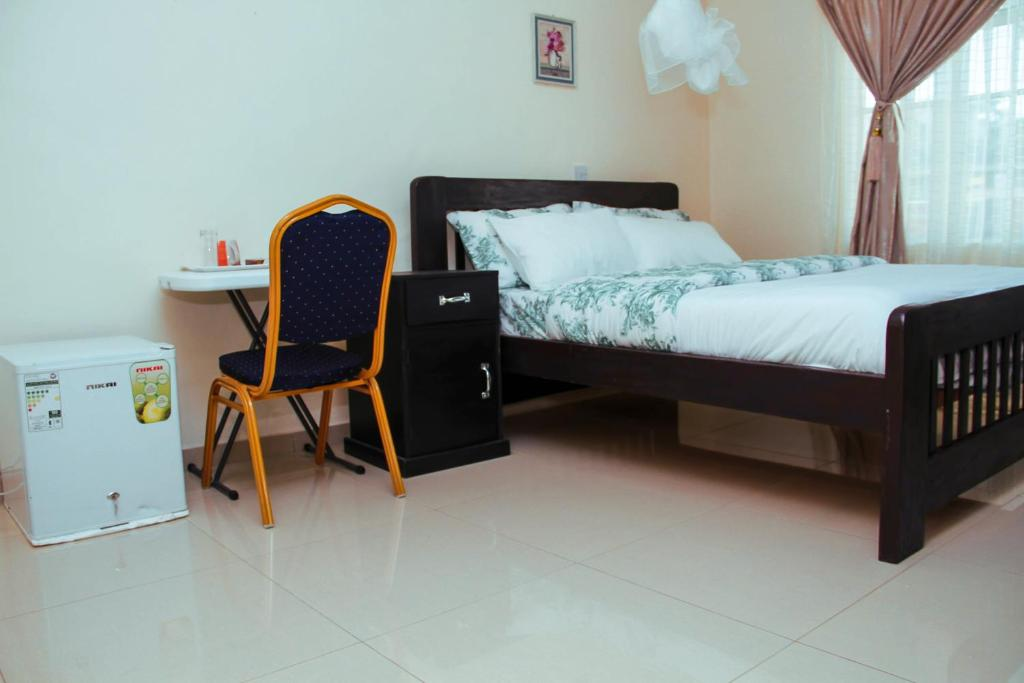 A bed or beds in a room at SCM Lodges & Apartments