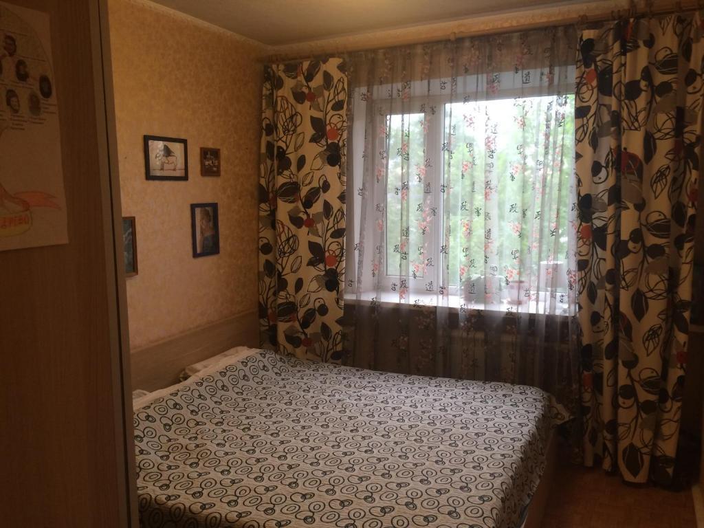 Кровать или кровати в номере Apartments on Sevasopolskaya