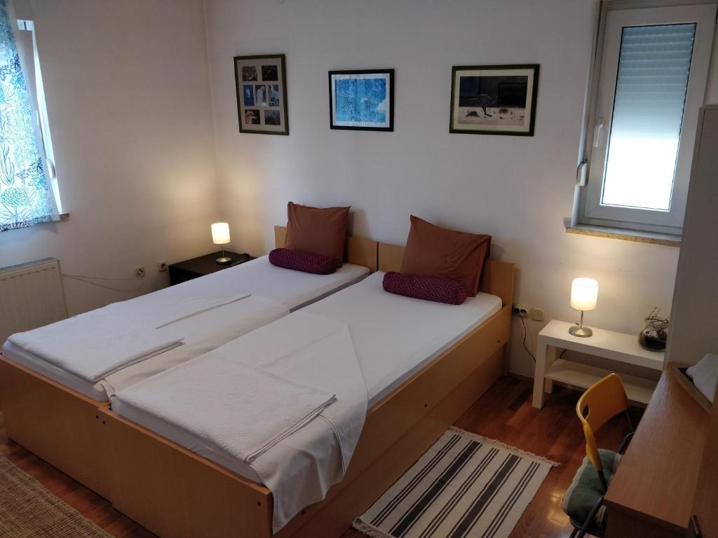 A bed or beds in a room at Savski Gaj Apartments