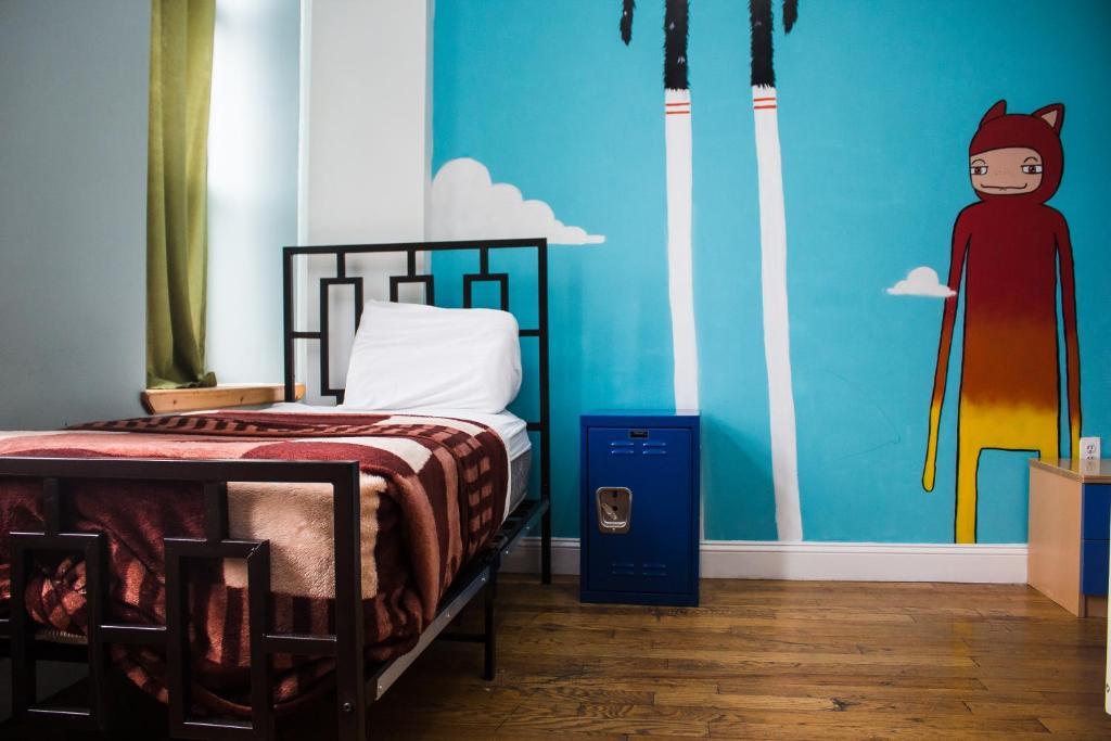 Un ou plusieurs lits dans un hébergement de l'établissement NY Moore Hostel