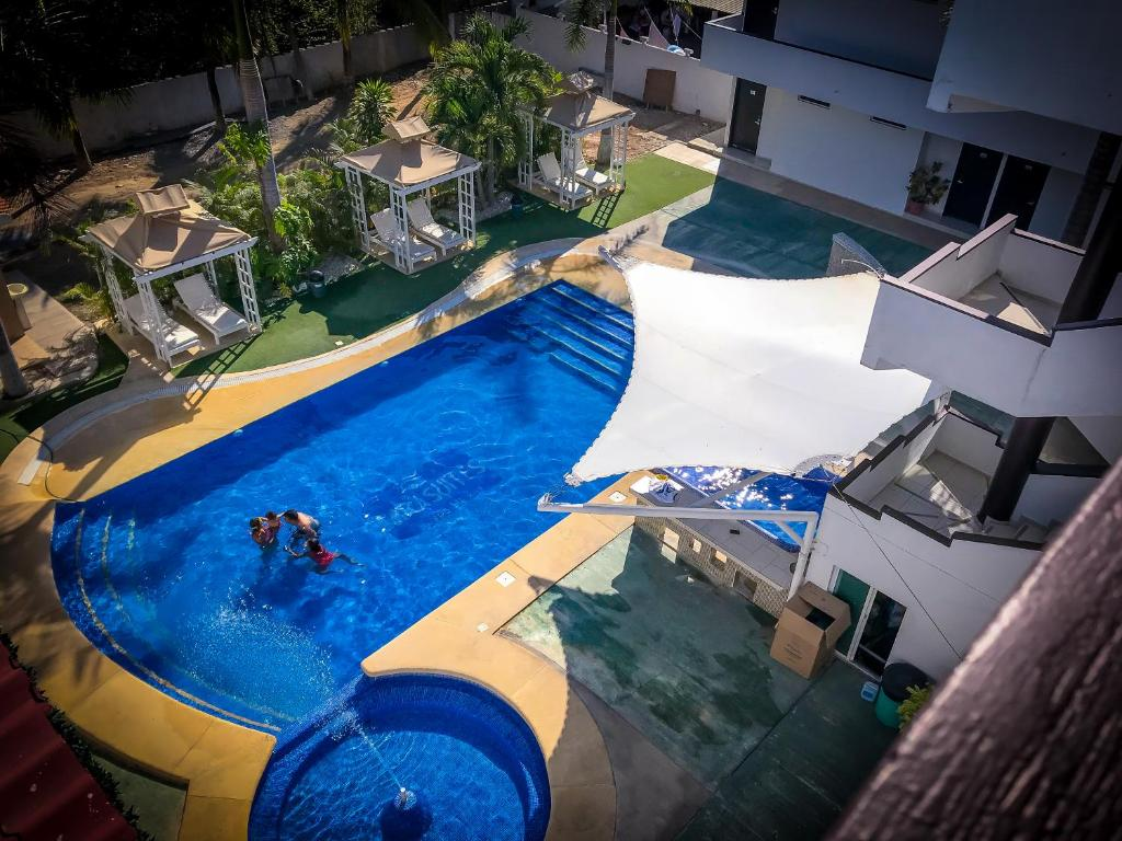 A view of the pool at Hotel Sara Suites or nearby